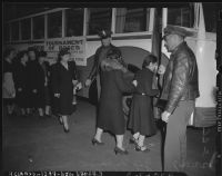 Japanese women board bus for evacuation and relocation