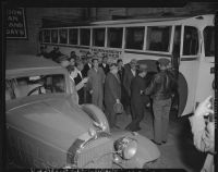 Japanese nationals board bus for evacuation and relocation, California, 1942