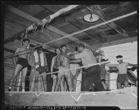 Boxing coach advises his athletes at an outdoor gymnasium, Los Angeles, 1942