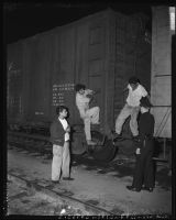 Undocumented Mexican workers arrested in rail yard, Los Angeles, 1953