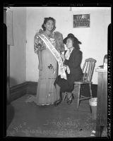 Miss Philippine Commonwealth of 1939 Gloria Talaugon with Guadalupe Palomo Malasig of Los Angeles, 1940