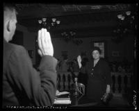 Bernadette Doyle being sworn in at State Senate Education Committee's Communism inquiry, Pasadena, 1950