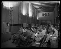 Doctors at an American Medical Association convention watching Dick Russell's televised heart surgery in Los Angeles, Calif., 1951