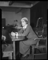 Evangelist Aimee Semple McPherson, at the witness stand.