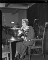Evangelist Aimee Semple McPherson, photographed at the witness stand.