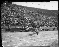 Jesse Owens competes in a race against USC track members at the Coliseum, Los Angeles, 1935