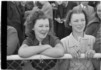 Two young women watch the races on opening day of Santa Anita's fourth horse racing season, Arcadia, December 25, 1937