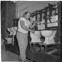 Employee making toilet bowls at the Universal Vitreous China Factory, Mentone, circa 1948